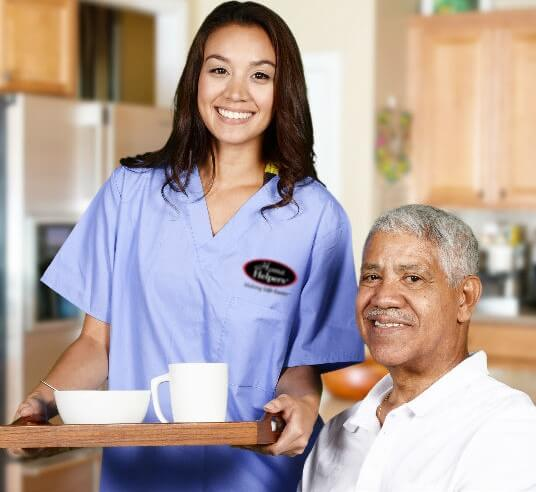 caregiver serving elderly man