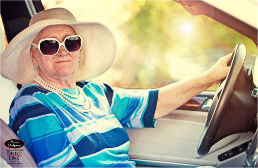 senior woman driving car with hat and sunglasses