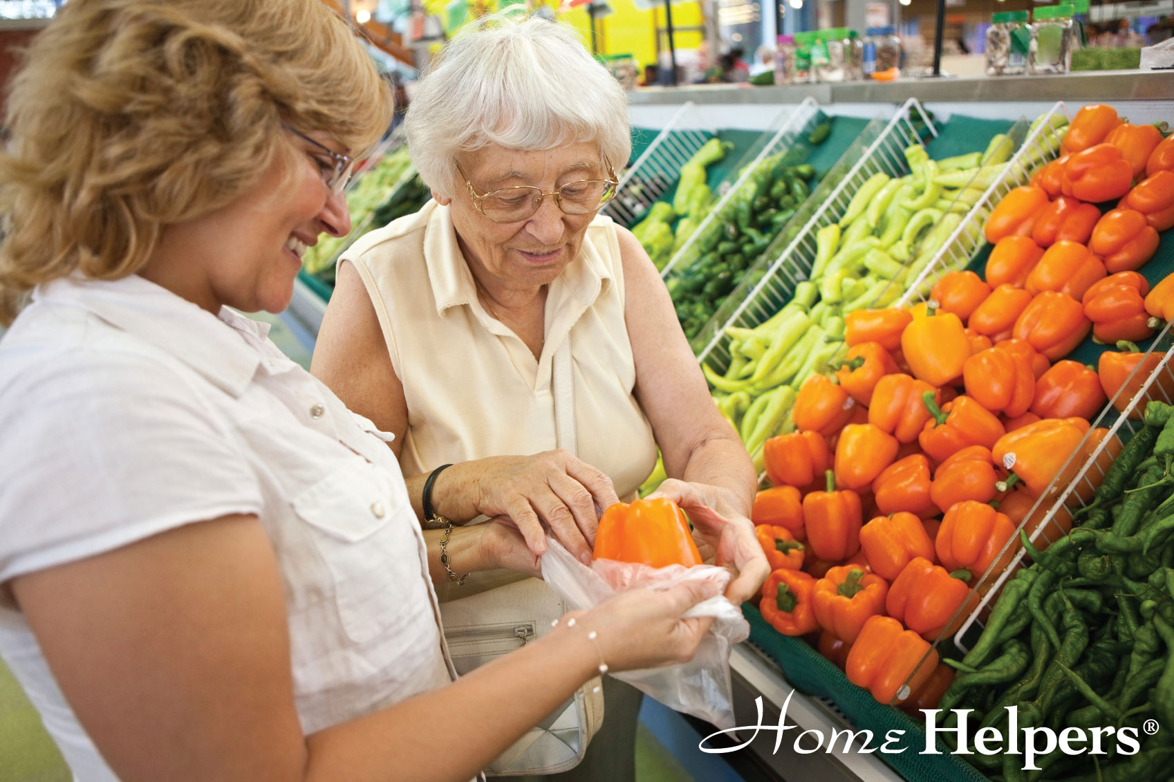 Home Helpers caregiver and client picking out produce