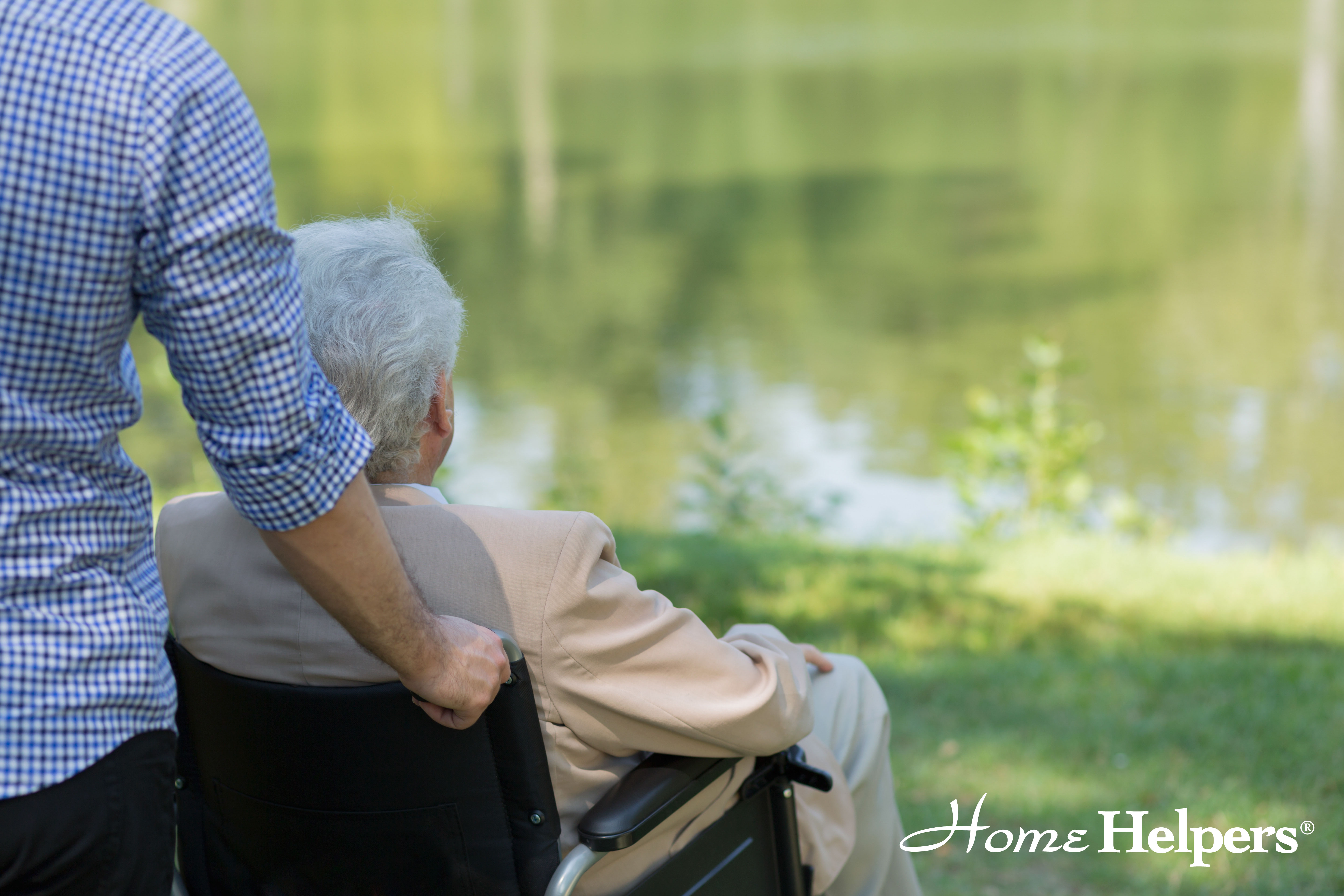 Home Helpers caregiver with client in a wheelchair at the park