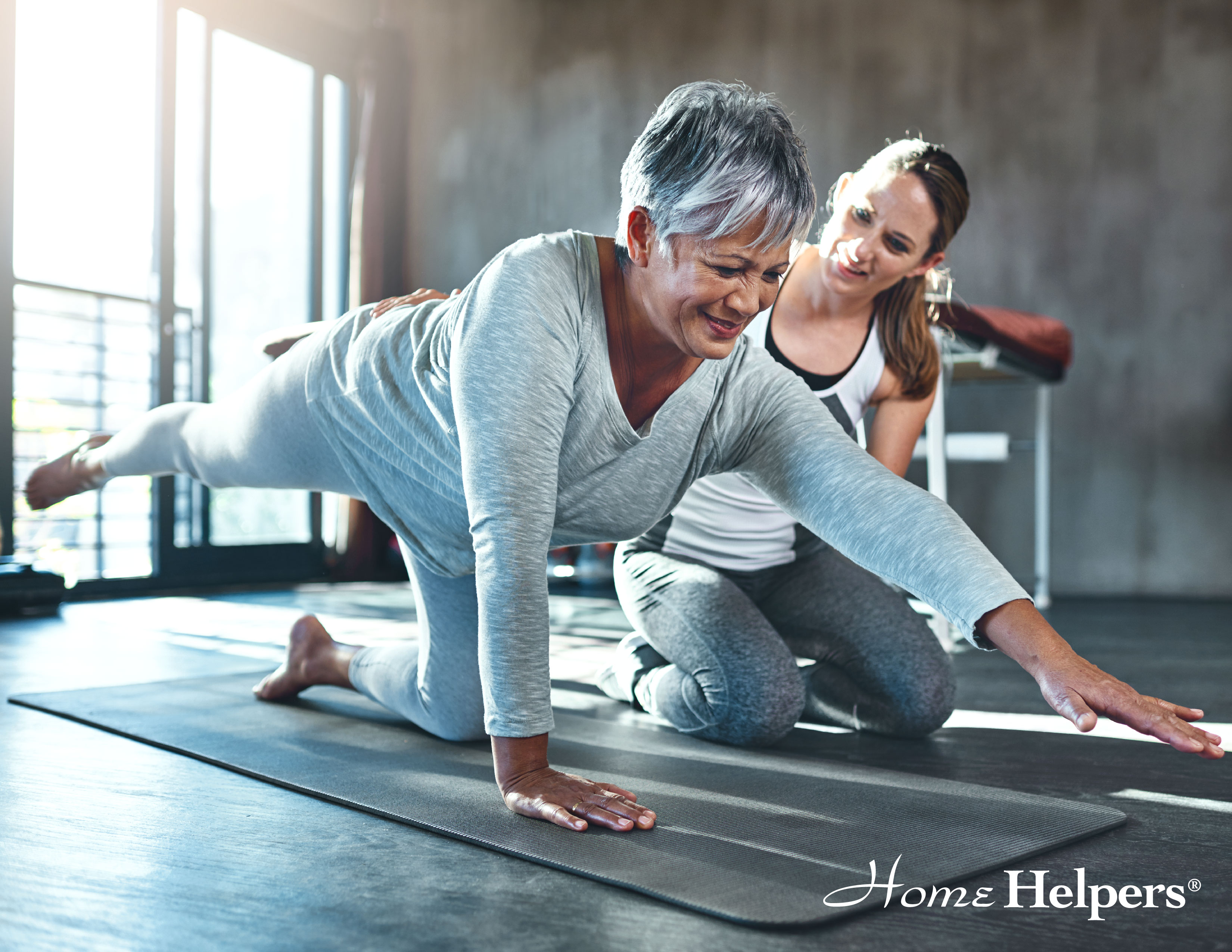 Home Helpers client exercising with caregiver