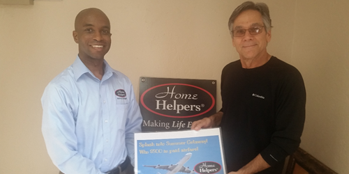 jonathan marsh, owner of home helpers bradenton posing with pete blews