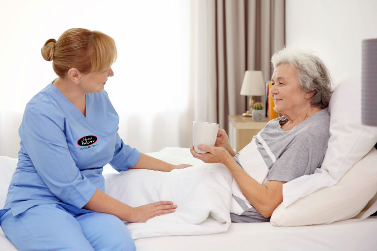 Caregiver caring for elderly woman